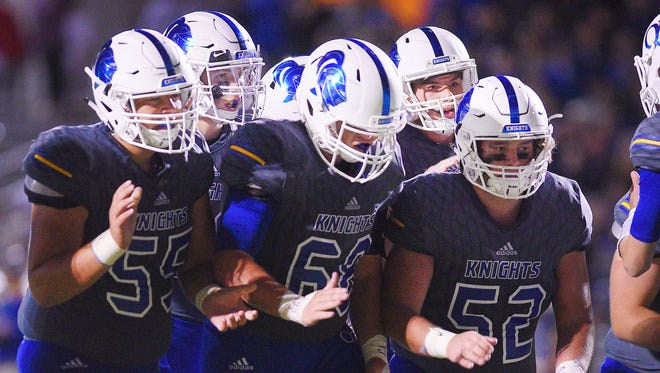 O'Gorman players break from a huddle during the game against Roosevelt Friday, Sept. 29, in Sioux Falls.