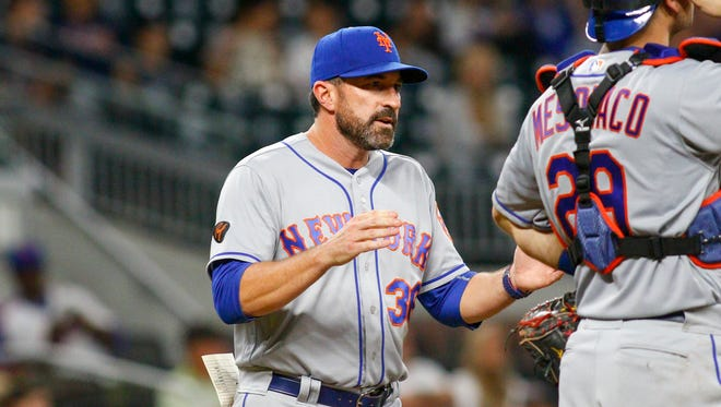 May 29, 2018; Atlanta, GA, USA; New York Mets manager Mickey Callaway (36) makes a pitching change against the Atlanta Braves in the seventh inning at SunTrust Park.