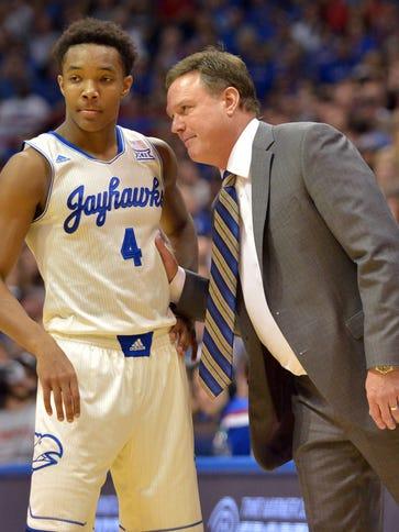 Kansas Jayhawks head coach Bill Self talks with guard