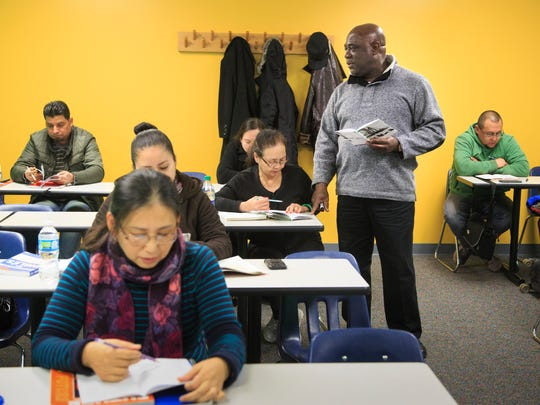 Vidal Spaine teaches an English as a second language night class at DMACC's urban campus Wednesday, Dec. 14, 2016.