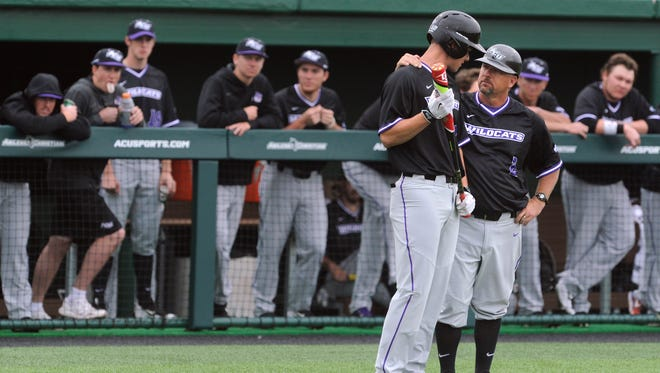 Abilene Christian University baseball coach Britt Bonneau speaks with batter Mark Pearson during a game against Michigan State University at ACU's Crutcher Scott Field. Bonneau on Saturday resigned for the position he held for 22 seasons.