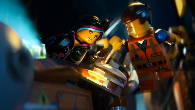 """Lego  minfigures Wyldstyle (voiced by Elizabeth Banks) and Emmet (Chris Pratt) in the animated motion picture """"The Lego Movie.?"""""""