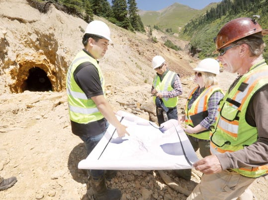 Sean Reyes, left, Utah attorney general, Cynthia H. Coffman, near right, Colorado attorney general, Craig Anderson, Center, Utah division director, Environment & Health Division, and Allen Sorenson, right, a geo-engineer, with the Colorado Division of Reclamation and Mining Safety, explains a map that shows all of the mine shafts in the mountain near the Gold King Mine on Wednesday, Aug. 19, 2015, during a tour of the mine that caused the spill in early August. (Jerry McBride/Durango Herald via AP)