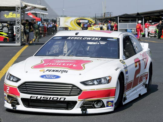 Brad Keselowski heads to the track during a practice session at Darlington Raceway in Darlington, S.C. Keselowski is on the pole for tonight's race.
