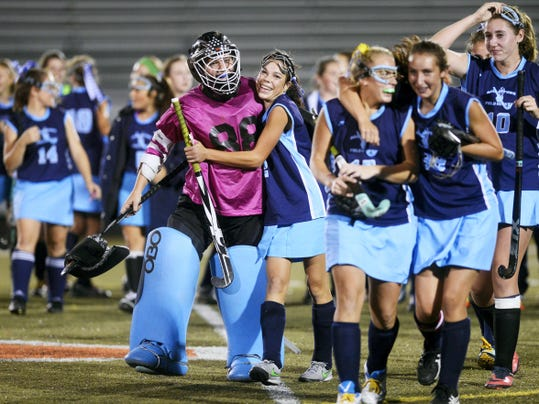 Dallastown field hockey players celebrate after beating Gettysburg, 1-0, in Wednesday's YAIAA tournament semifinal at York Suburban High School. In a rematch of last year's semifinal, the Wildcats got some redemption for last year's loss to the Warriors and advanced to Thursday's championship game against Bermudian Springs.