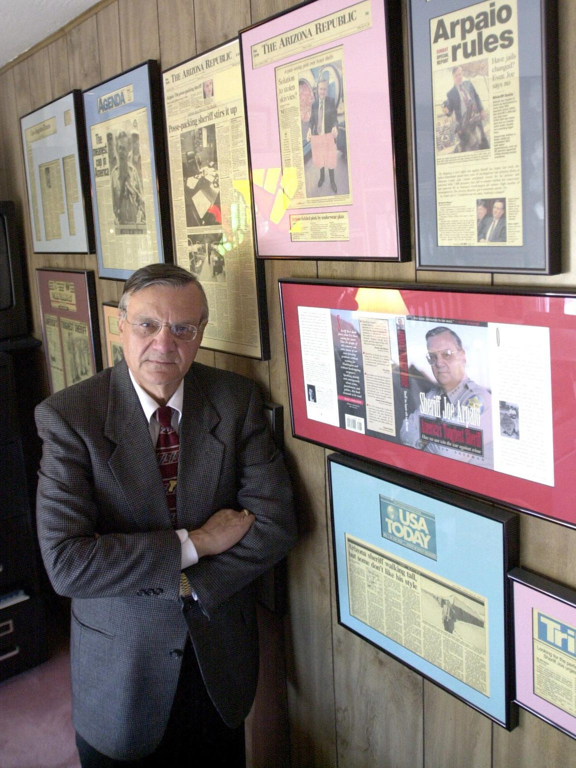Arpaio poses in his home office in 2001, during his third term as county sheriff.
