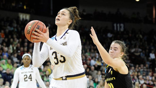 Notre Dame Fighting Irish forward Kathryn Westbeld (33) shoots the basketball against Oregon Ducks guard Sabrina Ionescu (20) in the championship game of the Spokane regional of the women's basketball 2018 NCAA Tournament at Spokane Veterans Memorial Arena.