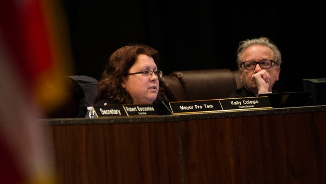From left, Warren City Councilwoman Kelly Colegio speaks as Warren City Councilman Ronald Papandrea listens during the Warren City Council meeting on Tuesday, Jan. 24, 2017 at the Community Center in Warren.