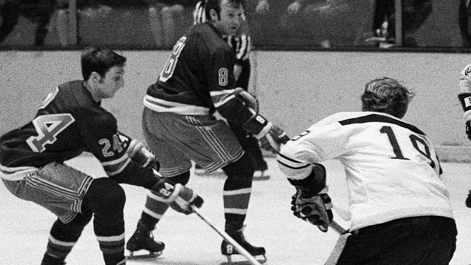 The Rangers' Bob Nevin (8), center, plays during Game 6 of the 1970 Stanley Cup quarterfinals against the Bruins in New York.