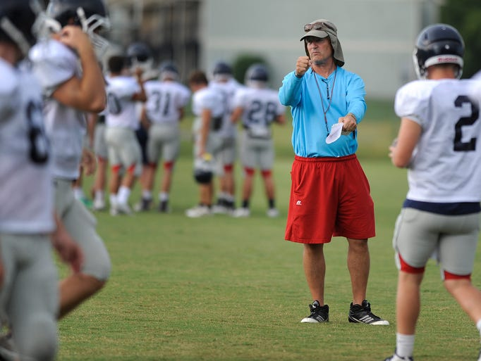 Head coach Randy Ragsdale works with players during football practice at the Trinity campus in Montgomery, Ala. on Friday August 8, 2014.