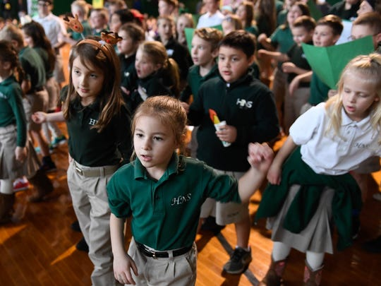 Nearly 300 Holy Name students participate in the school's