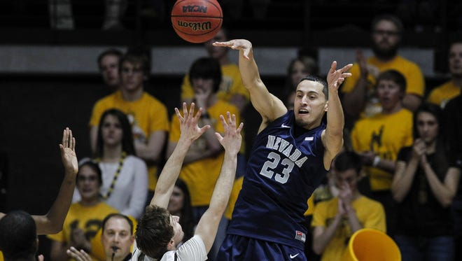 Wolf Pack guard Michael Perez makes a pass during Nevada's loss to Wyoming on Saturday.