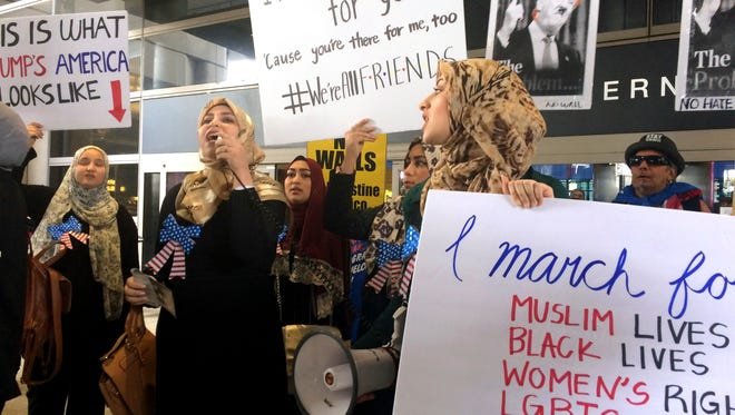 Protesters against President Trump's temporary travel ban on citizens from seven Muslim-majority nations stand in front of the Bradley Terminal at Los Angeles International Airport on Feb. 4, 2017, in Los Angeles after the order was lifted.