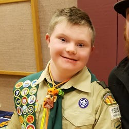 Father sues Boy Scouts of America saying son with Down syndrome was stripped of badges