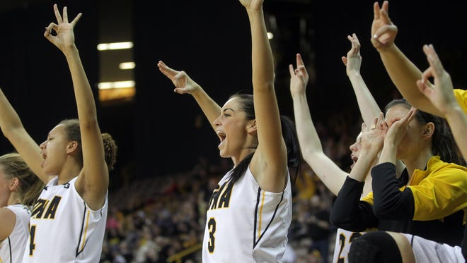 Iowa's Claire Till celebrates Melissa Dixon's 3-pointer during the Hawkeyes' game against Michigan at Carver-Hawkeye Arena on Thursday, Jan. 22, 2015.    David Scrivner / Iowa City Press-Citizen