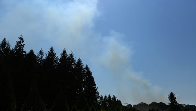 Smoke rises from a field fire just south of Stayton in Linn County on Saturday, Sept. 12, 2015.