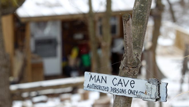 A sign welcomes guests to Perry Ross' man cave on Monday, Feb. 8, 2016.