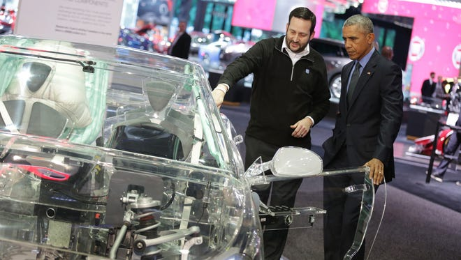 President Obama gets an explanation at the ZF display on how autonomous driving technology works from Bryan Johnson, Senior Manager, Corporate Communications, ZF North America the 2016 North American International Auto Show at Cobo Center downtown Detroit on January 20, 2016.