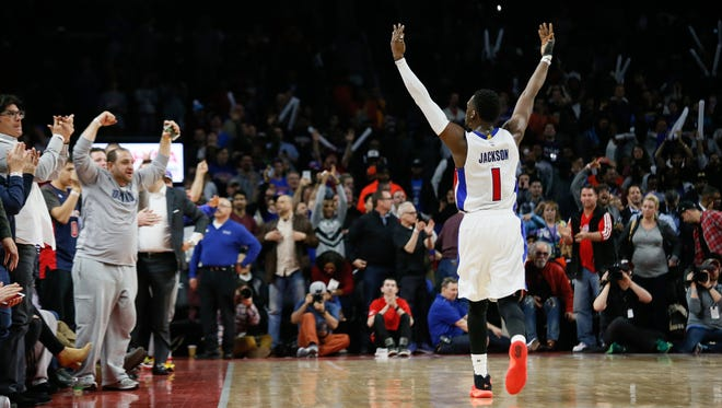 Detroit Pistons' Reggie Jackson lifts his hands up in the air bringing fans to their feet after defeating the Oklahoma City Thunder 88-82 at the Palace of Auburn Hills in Auburn Hills, Mich. on Tuesday, March 29, 2016. Kimberly P. Mitchell/Detroit Free Press