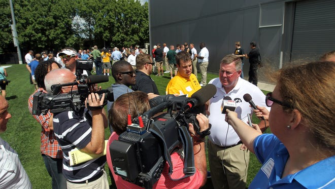 Iowa offensive coordinator and quarterbacks coach Greg Davis speaks to reporters during media day at the Kenyon Football Practice Facility on Saturday, Aug. 6, 2016.
