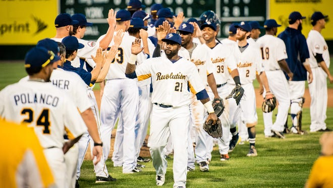 Led by Michael Burgess (No. 21), the York Revolution celebrated a win over the Long Island Ducks on June 22.