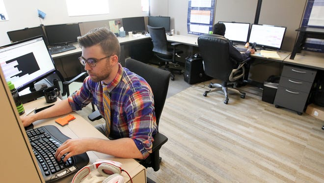 Travis Mathison, a subject matter expect at Higher Learning Technologies, works at their office in Coralville on Wednesday, Sept. 7, 2016.