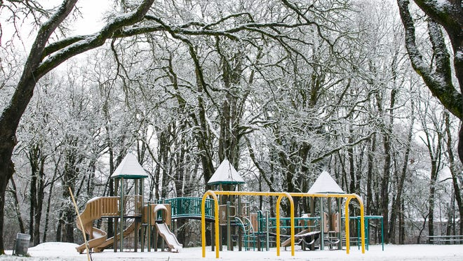 A light dust of snow sticks to playground equipment at Bush's Pasture Park in Salem on Wednesday, Jan. 11, 2017.