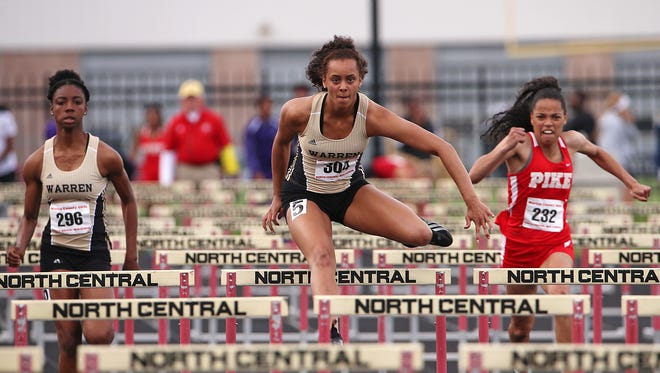 Hurdler Kayland Jackson, center, will  try to help Warren Central repeat as state champion. She is shown winning at Marion County meet May 10, 2016.