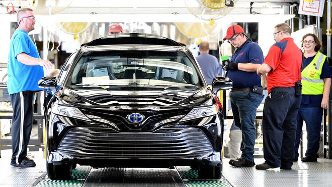 Team members inspect one of the first 2018 Toyota Camrys produced in Georgetown, Ky. in June 2017. The world's largest Toyota plant, Toyota Kentucky has produced more than 8 million Camrys in the past three decades.