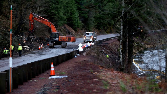 A backhoe removes contaminated soil at the site of a fuel tanker truck crash on Highway 22 at milepost 63 on Monday, Dec. 18, 2017. Highway 22 remains closed from east of Detroit to Highway 20 near the Santiam Pass.