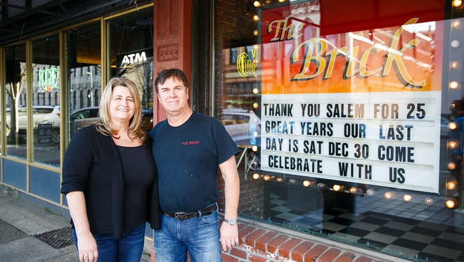 The Brick Bar and Broiler co-owners Bill and Sandy Salchenburg stand outside of the bar on their last day open after 25 years on Saturday, Dec. 30, 2017. The Salchenburgs opened the bar in 1993, and also own the Stonefront Tavern on Commercial.