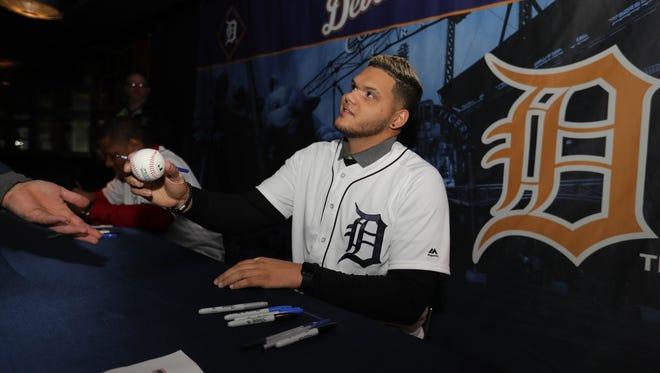 Tigers pitcher Joe Jimenez signs autographs during TigerFest at Comerica Park on Saturday, Jan. 27, 2018.