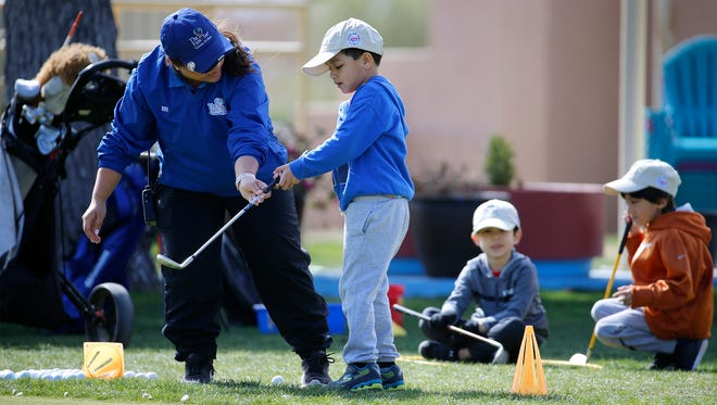 Brianna Aguilar, an instructor with The 1st Tee Greater El Paso Spring Break Camp, gives Ethan Fuentes 5, some instruction during the opening day of the golf camp at Ascarate Golf Course. This is the 10th year for the camp headed by executive director Kristi Albers.