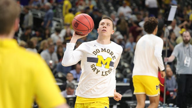 Michigan guard Duncan Robinson warms up before the national semifinal between Michigan and Loyola-Chicago on Saturday, March 31, 2018, at the Alamodome in San Antonio, Texas.