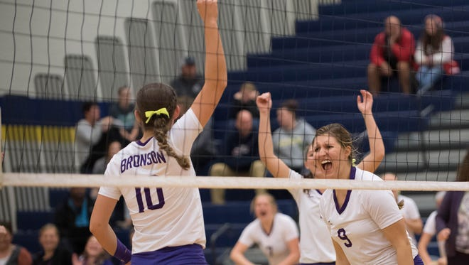 Bronson's Kiana Mayer (10) and Ashton Wronikowski (9) react after a point during the MHSAA Quarterfinals against Laingsburg Tuesday evening.