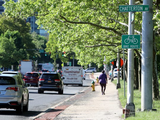 A sign marking Route 119 in White Plains as a bike route May 21, 2018.