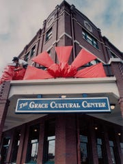 Greg Melin fights gusting winds to put the finishing touches on a giant bow at the Grace Museum Feb. 14, 1992. Known as the Drake Hotel until its restoration, the building reopened as the Grace in 1992 thanks to the efforts of the Abilene Preservation League and primary financing from the Dodge Jones Foundation.