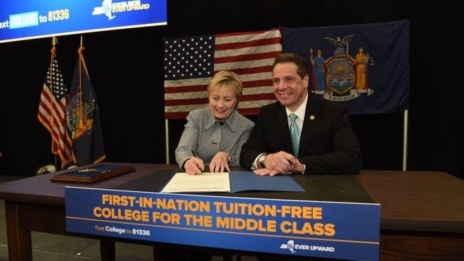 Gov. Andrew Cuomo signed the bill for New York's free tuition program into law with Hillary Clinton, the former New York senator and presidential candidate, in April 2017.  [USA TODAY NETWORK FILE PHOTO}