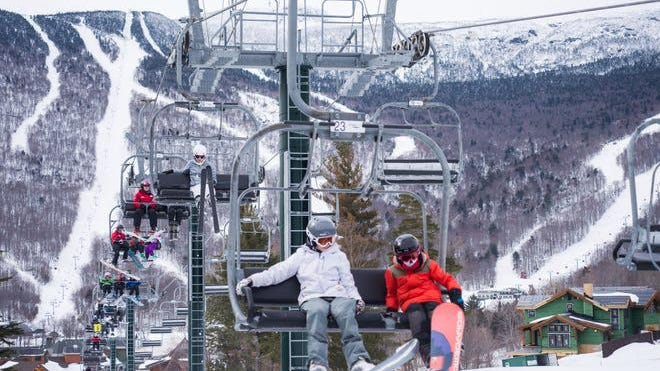 Skier and snowboarders make their way up the mountain at Stowe Mountain Resort in February 2017.