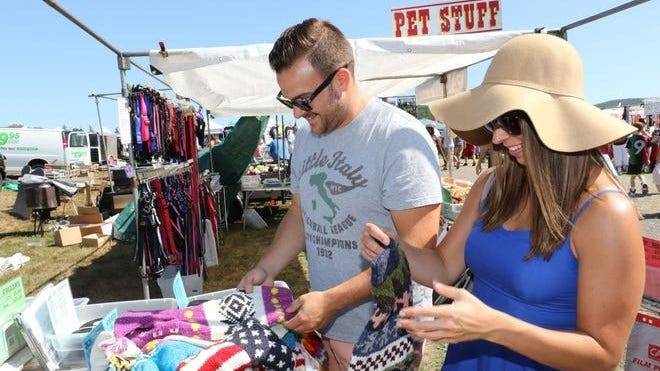 In this file photo, Frank and Carolyn Ruta of Harriman search for a sweater for their dog at the Stormville fleat market. Requiring all visitors to wear a mask is among the new safety measures thE site has instituted.
