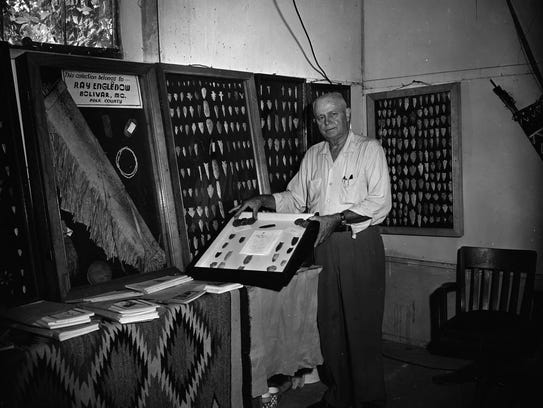 Walter M. Davis with a collection of Native American