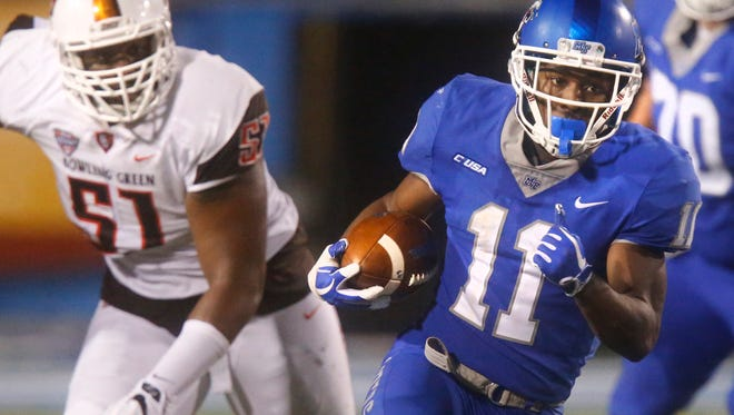 MTSU's Brad Anderson (11) runs away from Bowling Green's Malik Brown (51) during their game Saturday, Sept. 23, 2017. Anderson had 16 carries for 104 yards and six catches for 98 yards and a touchdown in MTSU's 24-13 win.