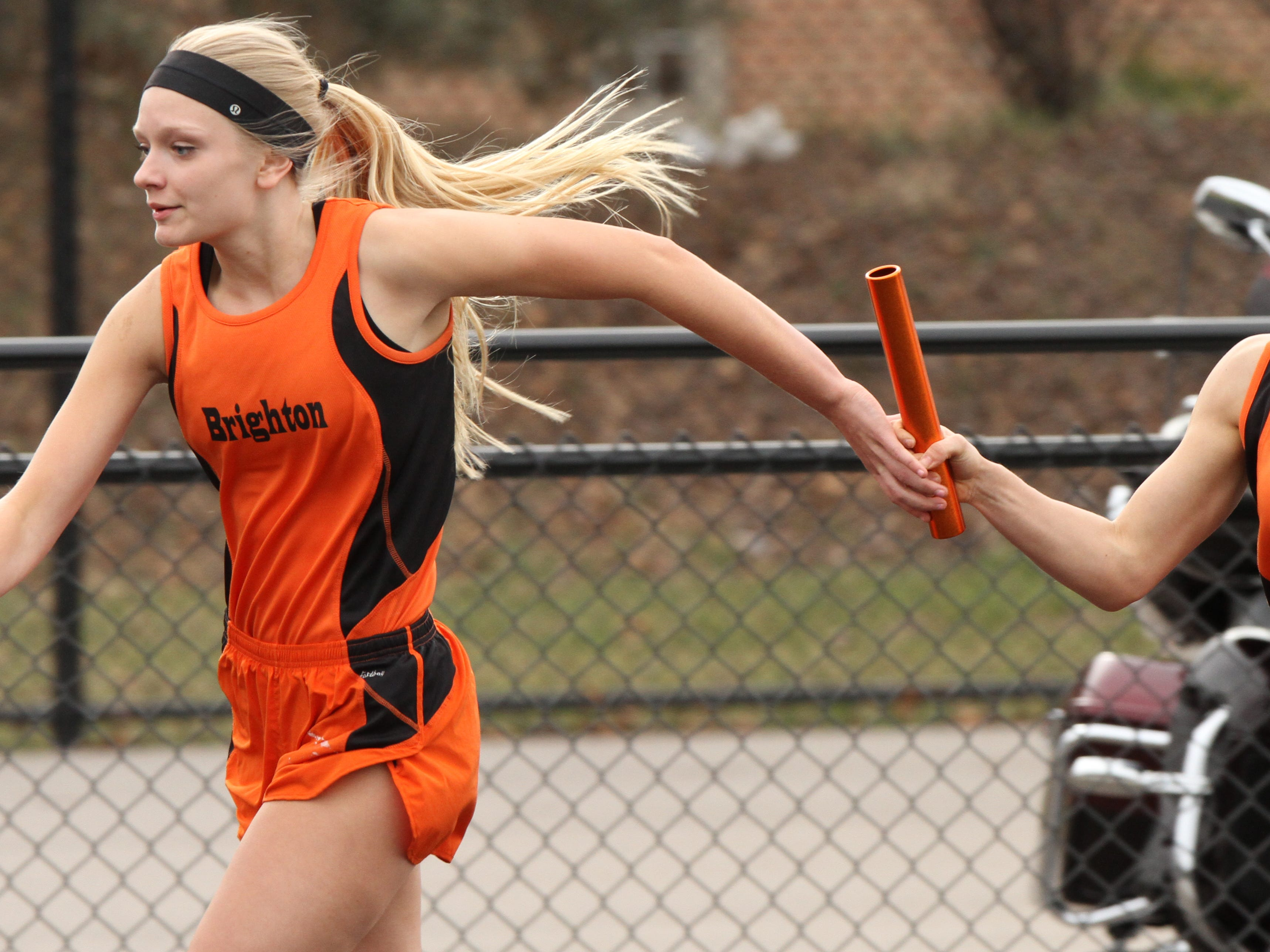 Brighton's Brooke Harrity places the baton in the hands of of team mate Shannon McGrath in the 4x200 relay.