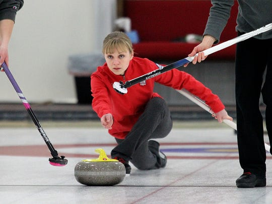 Toni Paisley of Onalaska lets a stone fly Sunday during curling action for the Badger State Winter Games at the Wausau Curling Center.
