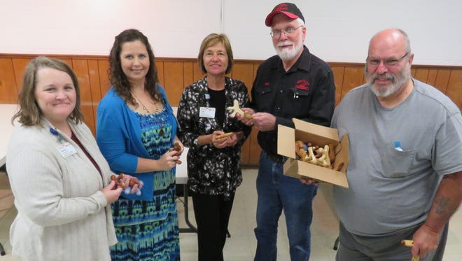 The North Arkansas Woodcarvers Club presented a donation to Hospice of the Ozarks of 41 comfort wood carvings. These carvings have a history of bringing comfort to patients who are gravely ill. Shown accepting the donation from Hospice of the Ozarks are Donette Boyett, family services, Angela Broome, outreach & development, and Julie Stewart, NAWC Club president, Sid Edelbrock, and Club vice president, Marty Wells.
