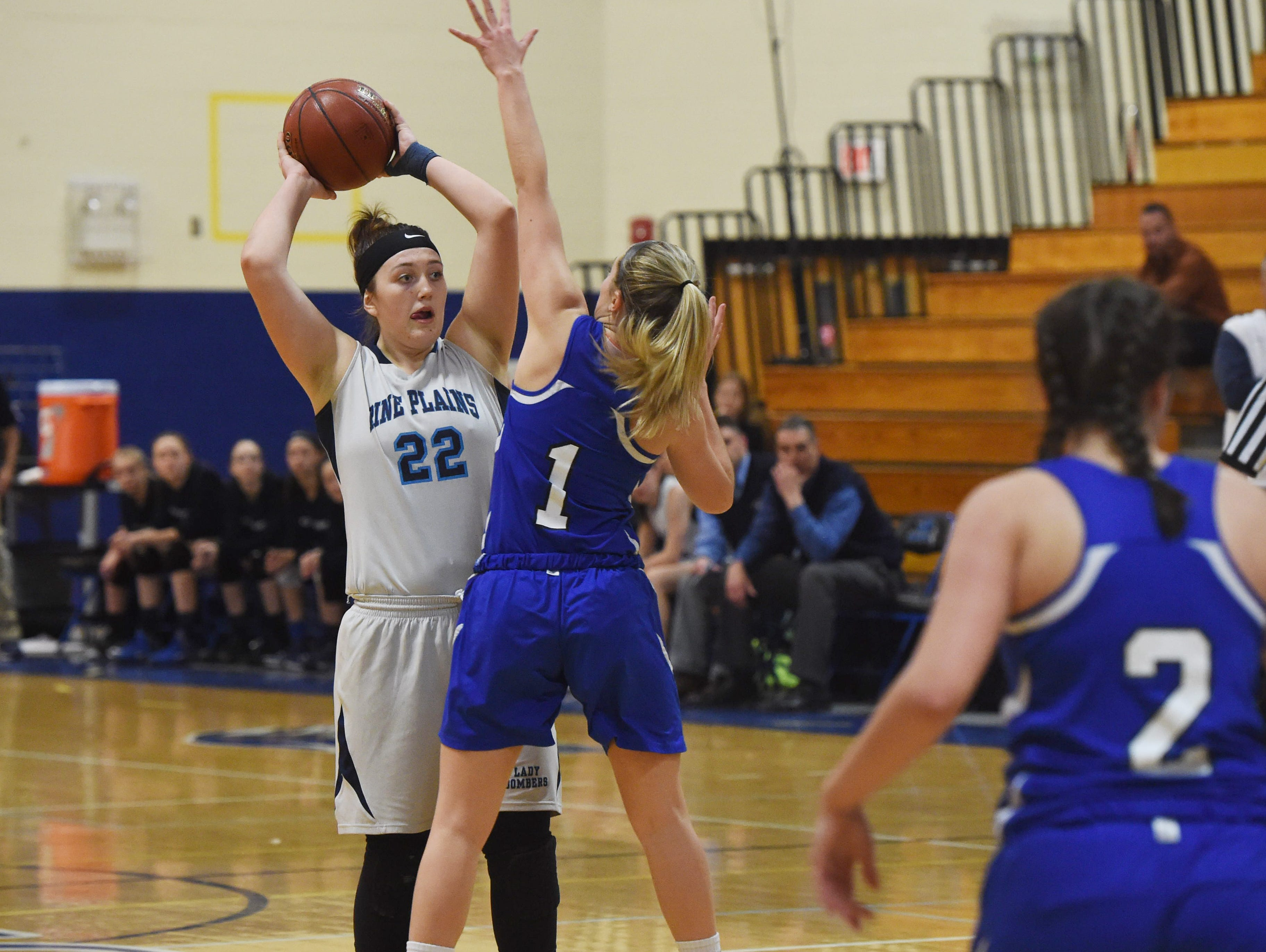 Pine Plains' Cathryn Simmons, left, looks for an open teammate during Friday's Section 9 championship game against Millbrook at Mount Saint Mary College in Newburgh.