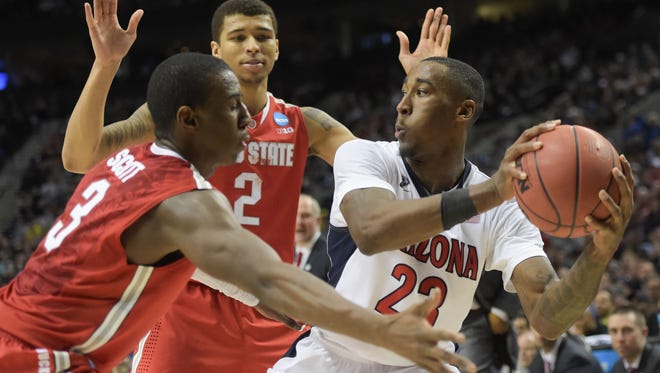 Arizona Wildcats forward Rondae Hollis-Jefferson (right) is defended by Ohio State Buckeyes guard Shannon Scott (3) and forward Marc Loving (2) during the second half in the third round of the 2015 NCAA Tournament at Moda Center. The Wildcats defeated the Buckeyes 73-58.
