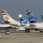 The tail of an Etihad aircraft is seen amid JetBlue planes in New York in this 2012 photo.