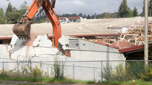 East High comes down.