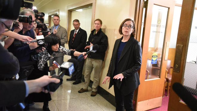 Kate Brown makes a brief statement to the media.